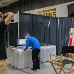 """UWO student Mathew Schulz takes professional headshots for students at the Career Fair on Tuesday Sept. 29 at Kolf Sports Center. """