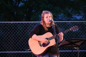 UW Oshkosh student Kelsey Johnson-Fisher sings and plays.