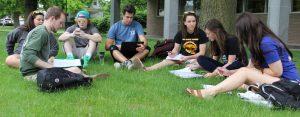 Members of Greek Life organizations on UWO's campus work on homework and study together outside of Polk Library.