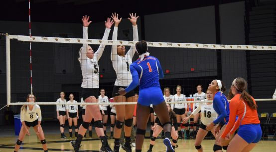 No. 5 Lexi Thiel and No. 1 Nerissa Vogt go up for a double block against the Pioneers on Wednesday night. Vogt recorded a total of three block assists and Thiel had two.