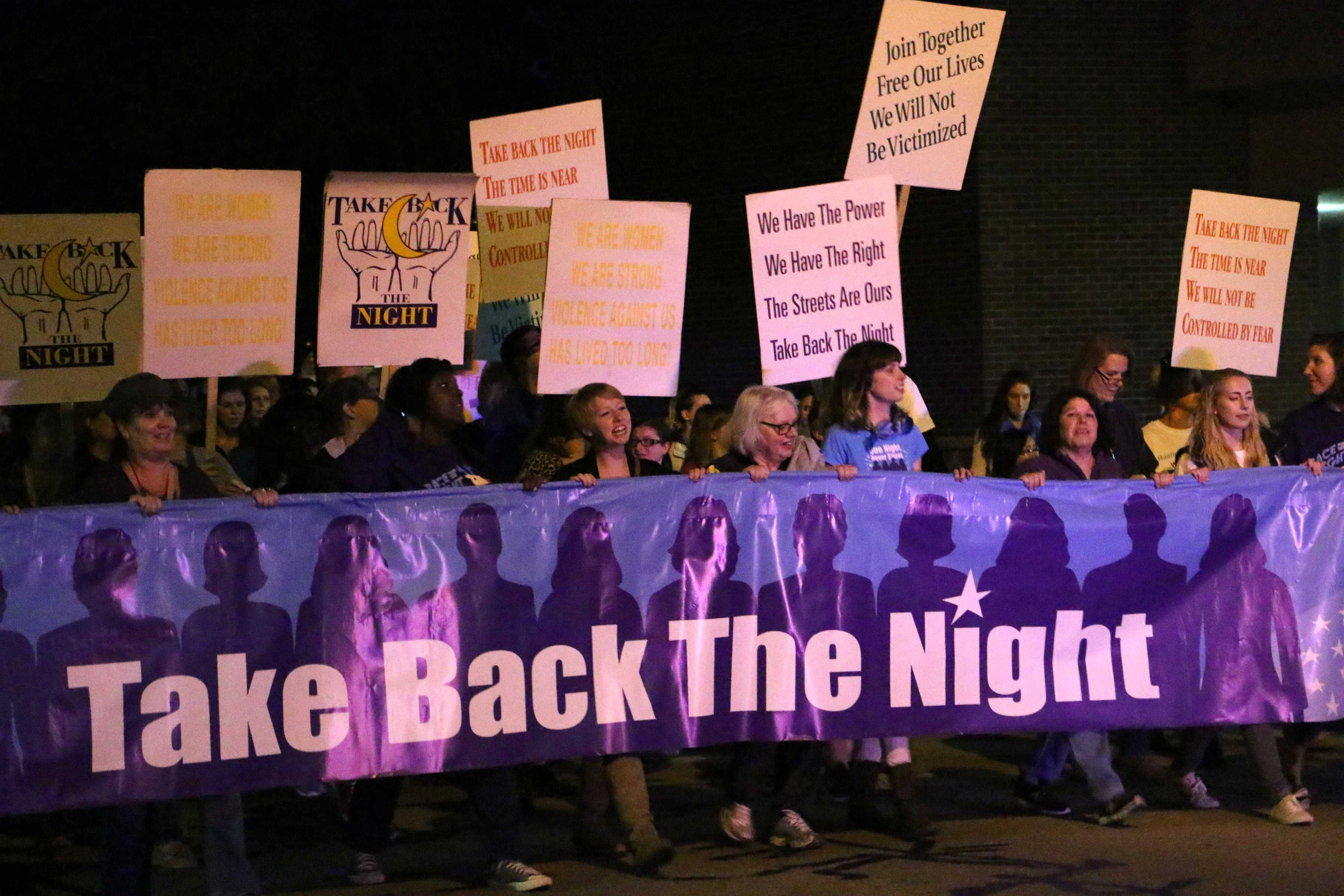 People march and chant through the streets of Oshkosh for domestic violence victims.