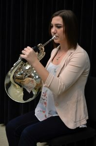 UWO student and music business major Katie Warren practices her French horn. Warren has been playing the instrument for over 13 years. She plans to work in the music business industry upon graduation from the University.