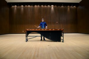 """UWO student Mason Lee is a performer and a composer. Below: Lee recently won a national title for his composition """"Of Light."""""""