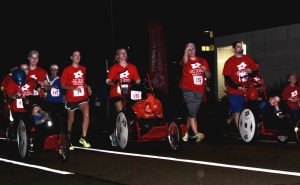 MyTeam Triumph members participate in Run With the Cops on Thursday. The event raised more than $49,000.