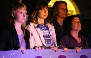 A group of participants look on during the Fox Valley Take Back the Night event at UW Oshkosh.