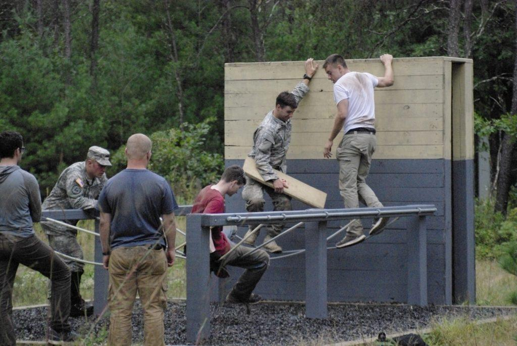 UW Oshkosh ROTC students work together to complete the group obstacle. Future officers participate in training with fellow ROTC members to enhance and hone their skills everyday.
