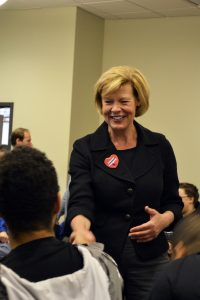 Tammy Baldwin shakes a student's hand in Reeve Memorial Union. Baldwin visited the College Democrats on Thursday.