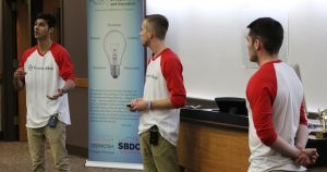 Austin Rosenberger listens to his business parter while he pitches their idea. Culver's business model contest awarded first place $15,000.