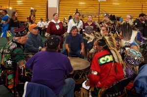 Dancers at the Pow-Wow gather around the Smokeytown drum circle as part of the Grand Entry ceremony.
