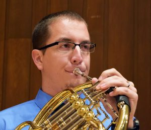UW Oshkosh student and recipeint of the Barry Tuckwell Scholarship Alex Witt plays the French horn.