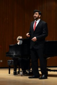Eli Baumann sings at his senior student recital. He was accompanied by Kristin Ihde on the piano and performed three different sets that featured Mozart.