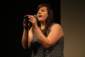 "Senior and winner of the talent show, Raven Wilson, sang ""Chasing Pavements"" by Adele as part of her competition."