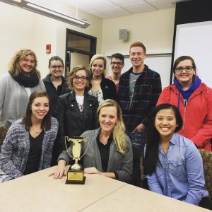 Dr. Sara Steffes-Hansen receives her faculty adviser of the year award with PRSSA members. Steffes-Hansen was the only faculty adviser in the nation to receive this award.