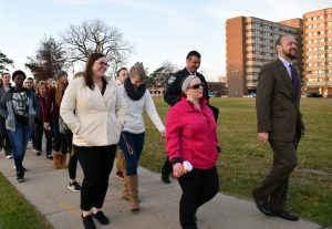 Chancellor Andrew Leavitt leads students in the Safety Walk across campus. Concerns with unsafe locations around UWO were brought up.