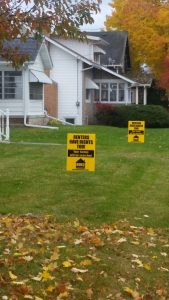 There are rental signs on Elmwood Avenue. The signs are a response to a city ordinance requiring housing inspections.