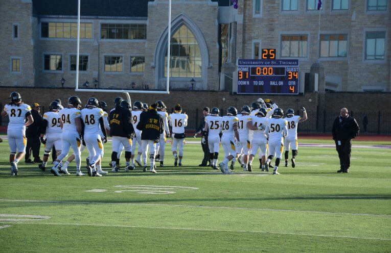 The Titans walk off the field after the victory against St. Thomas. UWO defeated St. Thomas 34-31 in the quarterfinal game and advance to play JCU.