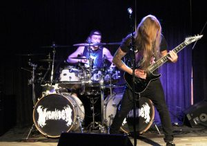 Tyler Lachowicz (drums, left) and Leighton Thompson (guitar, right) of Green Bay metal band, MICAWBER, perform at Metal Night in the Titan Underground Thursday night.