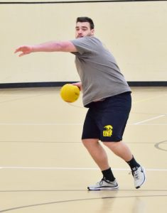 "UWO student, Matt Bublitz, from the team ""Patches O'houlihan"" launches a ball across the court in attempt to get an opponent out."