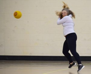 A Gamma Phi Beta member dodges a ball and is the last one on the court for her team.