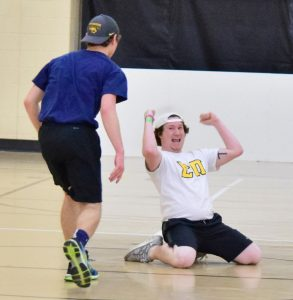 Members of Sigma Pi celebrate a last-second win at the dodgeball tournament on Sunday.