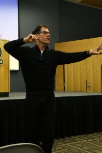 Fitness expert Tom Ryan describes the physical reaction that occurs when people see food that they really want at Tuesday night's Speaker Series event.