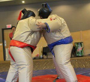 Senior Richelle Kasten and freshman Jose Y. Medina collide in a funny sumo battle.