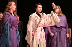 """Shayla Menter (left, First Witch), Matthew Beecher (middle, Sorcerer) and Maggie Grewal (Second Witch) perform a dark and powerful scene in the UW Oshkosh opera performance of """"Dido & Aeneas"""" on Sunday afternoon in the Music Hall."""