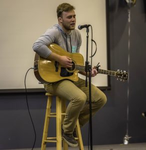 AJ Zemke sings an original song for the talent portion of the Mr. UWO competition in the Reeve Ballroom.