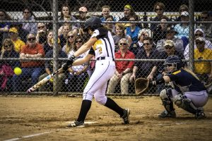 No. 2 Abby Menting hits the ball against UW Eau Claire on April 9. The Titans swept the Blugolds 2-0.