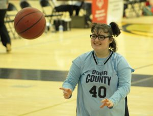 A Door County athlete passes the ball to a teammate during the 41st Annual Special Olympic games held at Kolf Sports Center.
