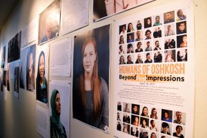 Photographs of Humans of Oshkosh's Beyond First Impressions exhibit are displayed in the Steinhilber Art Gallery.