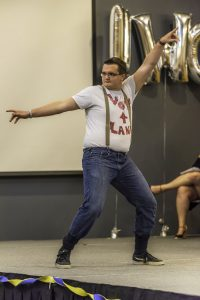 Lane Wohlrab performs an improvised dance routine as his talent during the Mr. UWO event Monday night.