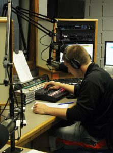 Junior communications major Brandon Beier DJs during the 90.3 WRST FM open house event Friday afternoon.