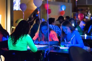 Katelyn Lipson, Brooke Lemkuil and Cortney Kallenberger play bingo during the Bye Gosh Fest announcement party on Thursday in the Titan Underground.