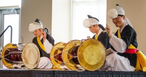 "Drummers play ""Sul-janggu,"" incorporating elegant dance moves and rhythms. This demonstrates the elegant technique of Korean drumming."