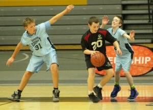 The Door County players defend and block their opponent from shooting a basket on Saturday.