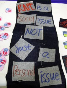 Denim is decorated with a quote for sexual assault awareness. Denim, a symbol to raise awareness of sexual assault, is hung up during the presentation for Denim Day.