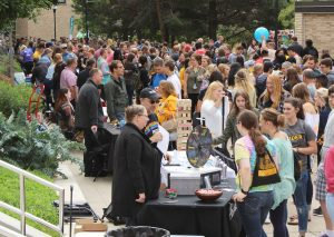 Students attend the annual Taste of Oshkosh event on Sept. 6, which is meant to introduce students to the 138 student organizations, 35 university departments, 1 6 volunteer agencies and 72 community businesses.