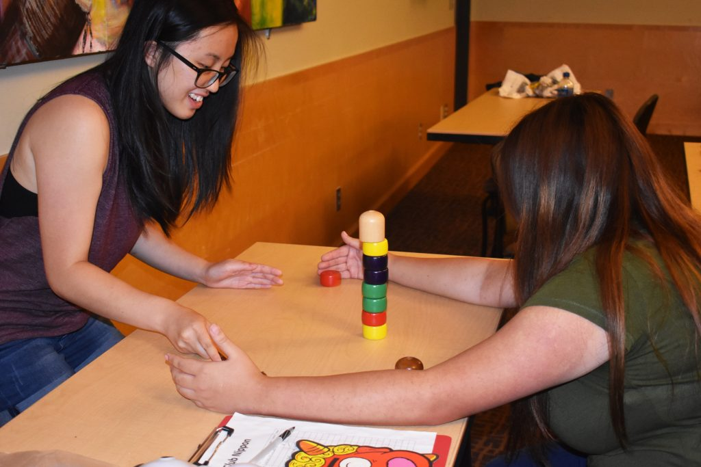 Students laugh while playing traditional Japanese games while attending Club Nippon Game Night on September 26th.