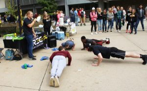 Students compete in a push-up contest hosted by the Student Recreation and Wellness Center.