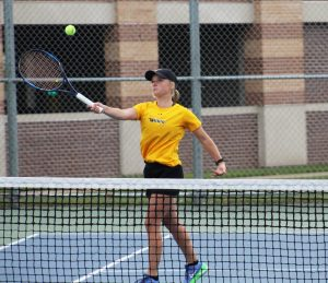 UWO sophomore Lesley Kutnink charges the net to return a ball during a home match.