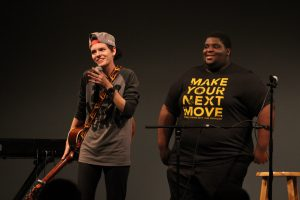 2017 UWO Homecoming talent show host Aza Muzorewa leads contestant Demetra Prochaska off stage following the act. The event showcased many student performers, illustrating the extreme diversity of talent among students across campus.