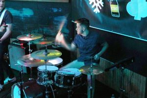 Drummer Lucas Goebel keeps a beat to one of the band's original songs during the Friday night performance.
