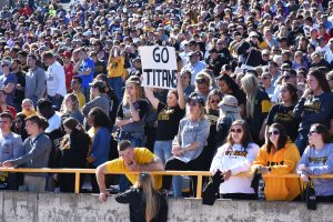 Oshkosh students and fans pack the stands as they watch the Oshkosh-Whitewater game on Saturday. For the contest, the recorded attendance was 5,781, and rally towels were handed out before the game to supporters.