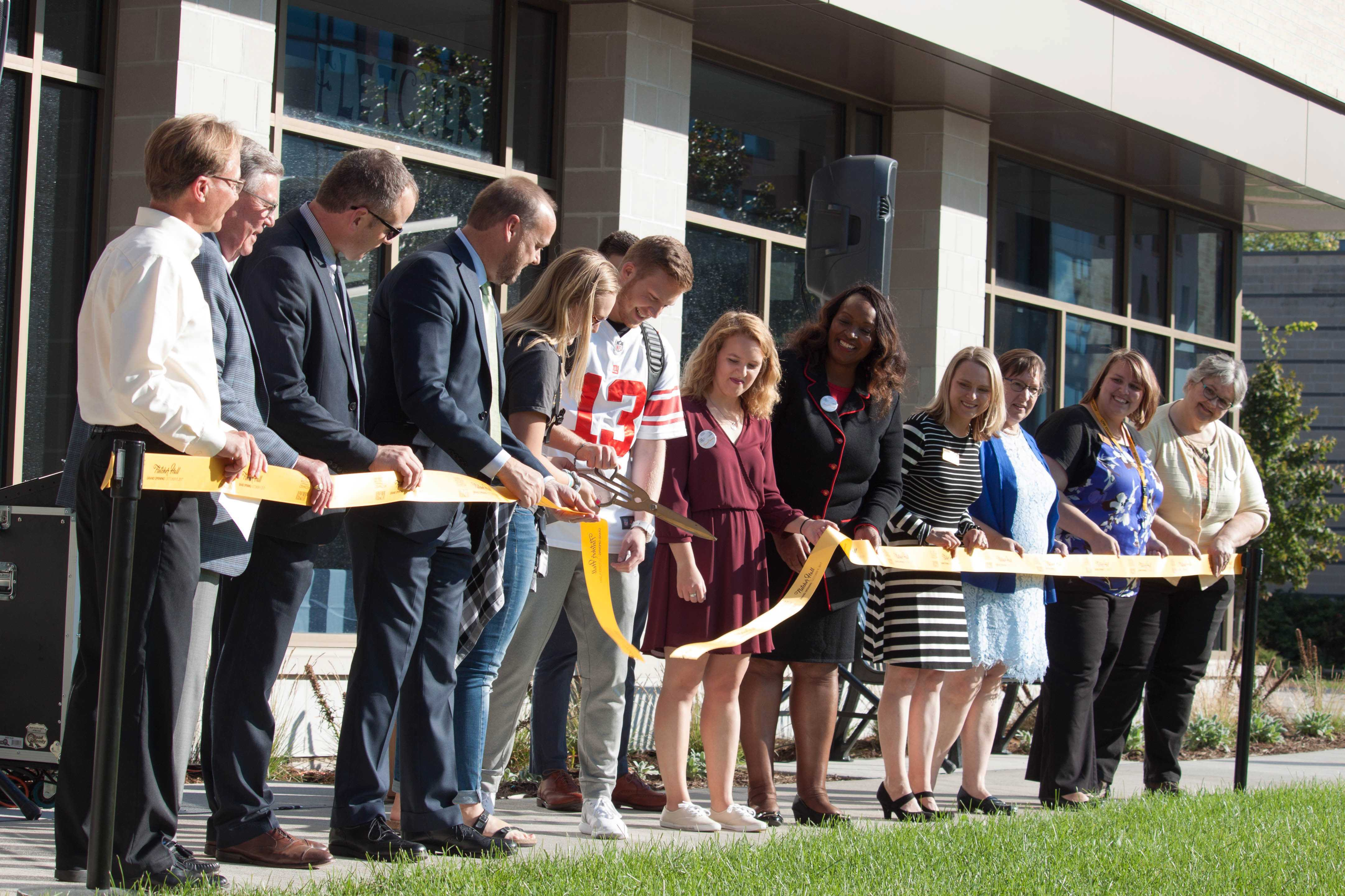 Ribbon cutting marks opening of new buildings