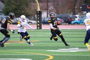 UW Oshkosh junior wide receiver Dom Todarello runs from a Lakeland defender in the WIAC playoffs.