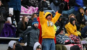 UW Oshkosh fans leap with excitement during the Titans second round playoff matchup against North Central College (Ill.)