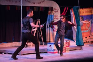 """Matt Peplinski (left) and Matt Beecher (right) perform a choreographed sword fight during a dress rehearsal. """