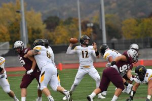 Oshkosh quarterback Brett Kasper stands tall in the pocket and looks downfield for a receiver Saturday against La Crosse. For the game, Kasper tied a career high with four touchdowns.