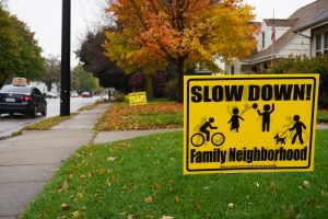 A sign in the front yard of a Jackson Street house asks drivers to slow down to make the community safer. According to a study in 2016, there were 807 accidents in intersections in 2016 and 694 in 2015.